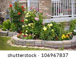 Stock photo natural stone landscaping in home rose garden 106967837