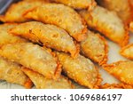 close up of curry puff  | Shutterstock . vector #1069686197