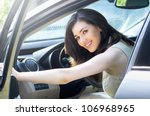 Girl sitting in the car - stock photo