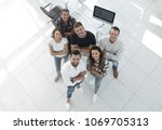 young professionals standing...   Shutterstock . vector #1069705313