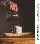 pouring coffee in cup | Shutterstock . vector #1069766147