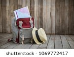 map in backpack and hat in wood ... | Shutterstock . vector #1069772417