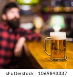 glass with beer on bar counter  ... | Shutterstock . vector #1069843337