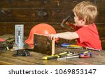toddler on busy face plays with ... | Shutterstock . vector #1069853147