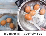 chef putting boiled eggs  in... | Shutterstock . vector #1069894583