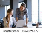 young smiling coworkers woman... | Shutterstock . vector #1069896677