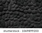 black stone wall texture.... | Shutterstock . vector #1069899203