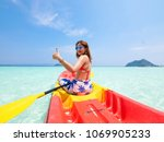 asian woman on the kayak boat... | Shutterstock . vector #1069905233