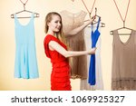 woman in shop or wardrobe... | Shutterstock . vector #1069925327