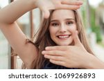 smiling young woman outside in... | Shutterstock . vector #1069926893