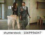 business partners walking...   Shutterstock . vector #1069956047