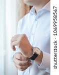 the man adjusts the watch on... | Shutterstock . vector #1069958567