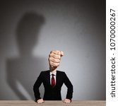 the man in a suit with a head... | Shutterstock . vector #1070000267