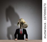 the man in a suit with a head... | Shutterstock . vector #1070000273