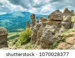 Small photo of Rock formations of the Demerdji mountain, Crimea, Russia. Valley of Ghosts, landmark of Crimea. Beautiful summer landscape of Crimea in summer. Scenery and nature in Crimea.