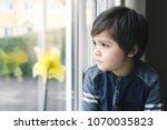 portrait of upset little boy... | Shutterstock . vector #1070035823