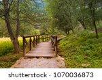 small rustic wooden bridge and... | Shutterstock . vector #1070036873