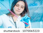 young woman technician uses a... | Shutterstock . vector #1070065223
