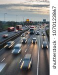 evening traffic drives along... | Shutterstock . vector #1070123867