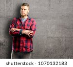 young handsome man nervous and... | Shutterstock . vector #1070132183