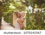 happy family  active mother... | Shutterstock . vector #1070141567