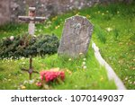 tomb with stone cross and... | Shutterstock . vector #1070149037