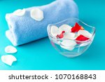 rose petals in a bowl with... | Shutterstock . vector #1070168843