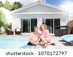 smiling senior couple sitting... | Shutterstock . vector #1070172797