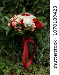 Small photo of Wedding bouquet with marsala flowers
