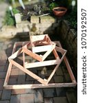 Small photo of Potato pyramid, wooden construction