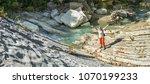 woman enjoying the nature. | Shutterstock . vector #1070199233