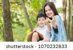 mom and boy kid show hand with... | Shutterstock . vector #1070232833