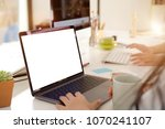 cropped shot of woman working... | Shutterstock . vector #1070241107