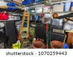 messy residential garage packed ...   Shutterstock . vector #1070259443