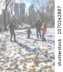 Small photo of Family playing in the snow. Bokeh effect, backgroud effect.