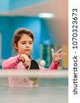 little serious girl playing... | Shutterstock . vector #1070323673
