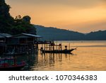 silhouette fishing village near ... | Shutterstock . vector #1070346383