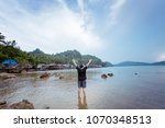woman stand at the sea feeling... | Shutterstock . vector #1070348513