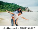 young happy couple  making... | Shutterstock . vector #1070359427