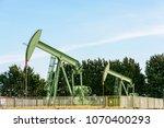 two active pumpjacks pumping... | Shutterstock . vector #1070400293
