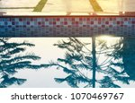 swimming pool with sunny. | Shutterstock . vector #1070469767