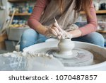 handcrafted on a potter's wheel ... | Shutterstock . vector #1070487857