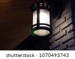 classic night lamp on wall... | Shutterstock . vector #1070493743
