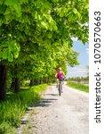 woman cycling a mountain bike... | Shutterstock . vector #1070570663