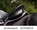 Saddle on a black horse - stock photo