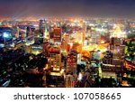 a view over the big asian city of Bangkok , Thailand at nighttime when the tall skyscrapers are illuminated - stock photo