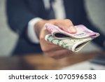 businessman giving money in the ...   Shutterstock . vector #1070596583