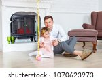 dad and daughter are posing at... | Shutterstock . vector #1070623973