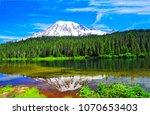 mountain snow peak forest river ... | Shutterstock . vector #1070653403