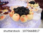 apples and grape in glass bowl... | Shutterstock . vector #1070668817
